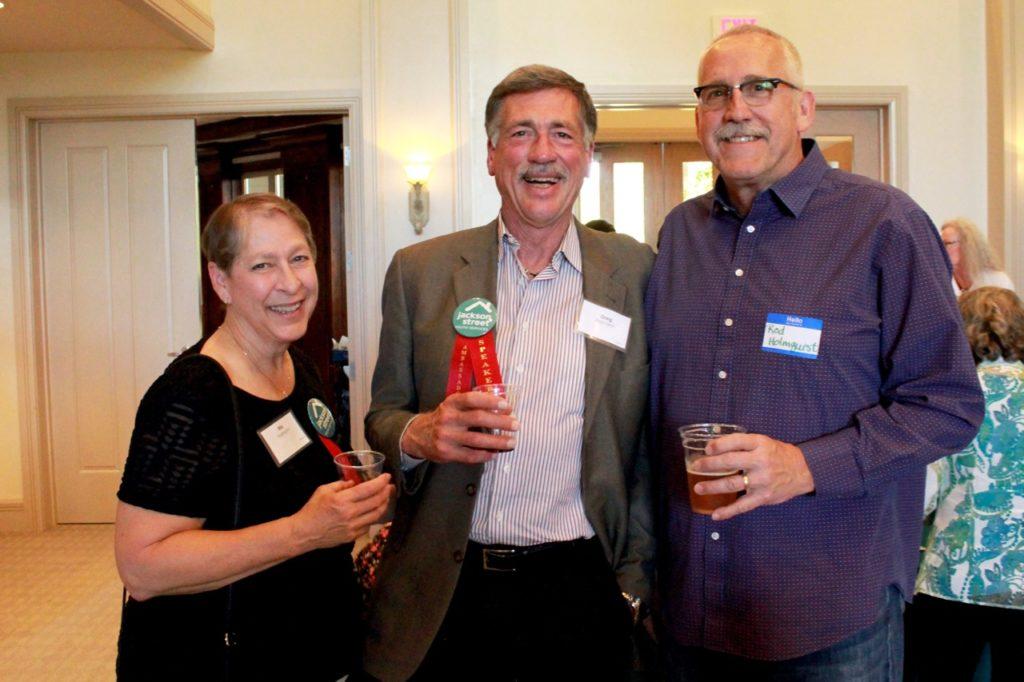 Three ambassadors smiling
