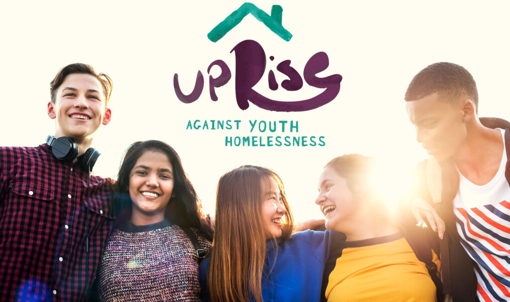 Group of teens smiling and laughing with Uprise Against Youth Homelessness logo